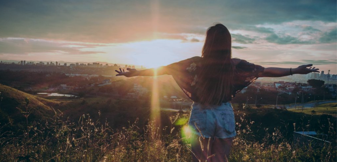 Woman on Mountain Watching Sunrise